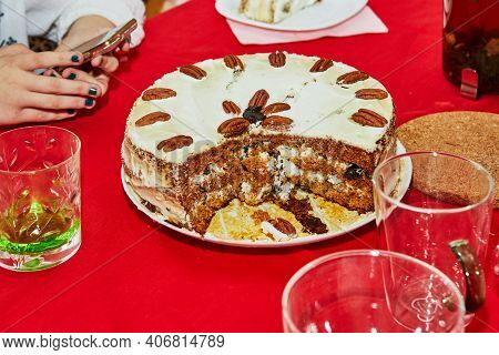 Party Cake, Cut Into Pieces With A Knife On The Table