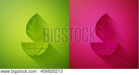 Paper Cut Earth Globe And Leaf Icon Isolated On Green And Pink Background. World Or Earth Sign. Geom