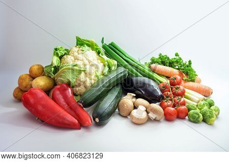 Healthy Fresh Vegetables Of Different Varieties On A Light Gray Background, Diet Food Concept For Fi