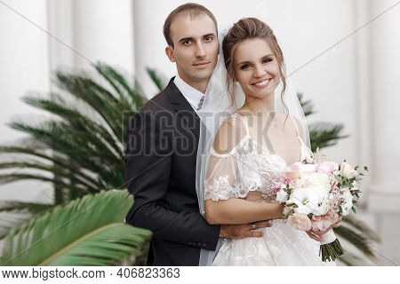 Bride And Groom At Wedding Day Walking Outdoors On Castle Territory In Summer. Bridal Couple, Newlyw