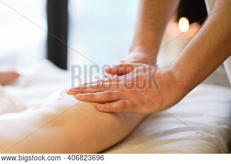 Detail Of Hands Massaging Human Calf Muscle.therapist Applying Pressure On Female Leg. Hands Of Mass