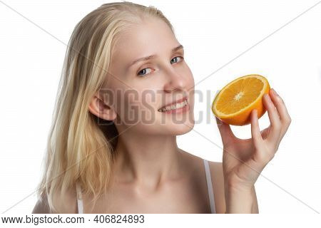 Beauty. Smiling Woman With Radiant Face Skin And Orange Portrait. Vitamin C Cosmetics Concept