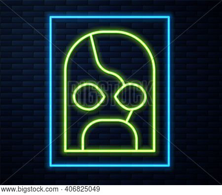 Glowing Neon Line Mexican Wrestler Icon Isolated On Brick Wall Background. Vector