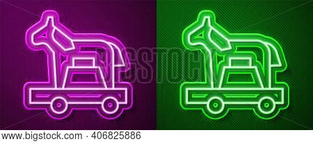 Glowing Neon Line Trojan Horse Icon Isolated On Purple And Green Background. Vector
