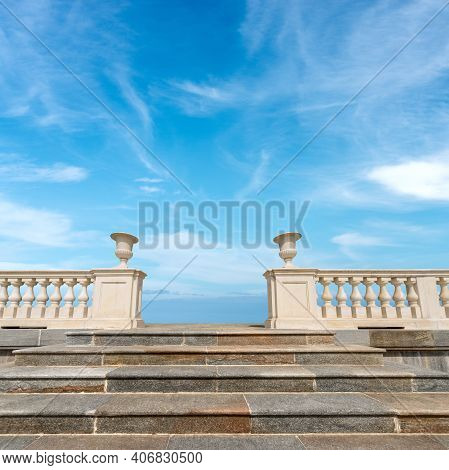 Closeup Of A Marble Stairway And A White Balustrade With Blue Sky And Clouds On Background.