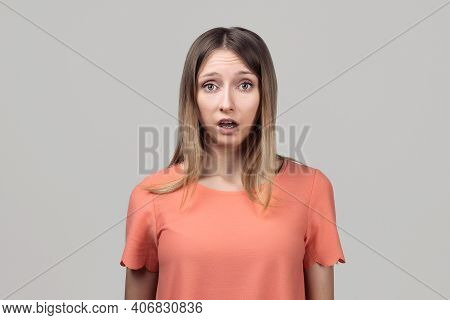 Worried And Concerned Blond Girl In Casual Clothes Is Looking With Surprised Expression, Clueless Ho