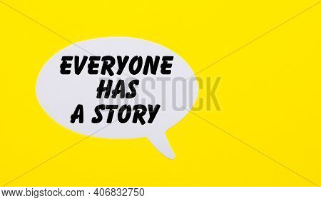 On A Bright Yellow Background, White Paper With The Words Everyone Has A Story