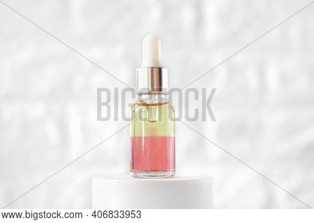 Peptides Nourishing Oil In A Glass Bottle With Dropper. Two Phase Face Oil Enriched With Anti Age Co