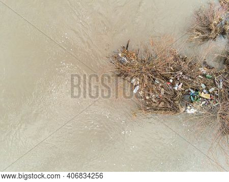 Sansimion, Romania- 06 February 2021: Aerial View, Plastic Bottles In The Dirty Olt River.