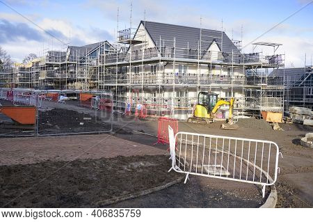 House Development Construction Site In Progress With Scaffold