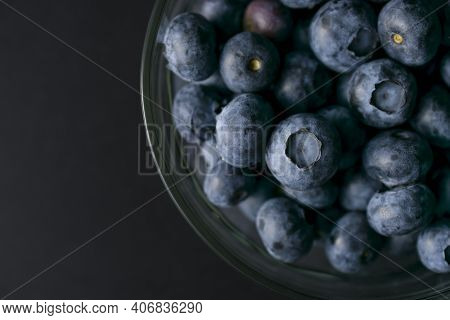 Bowl Of Blueberries On Black Background. Macro Photography Of Fresh Blueberries. Ripe Blueberries Ba