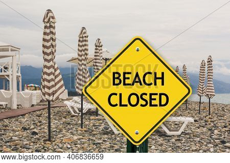Beach Closed Sign. Public Beaches & Parking Are Closed To Help Stop The Spread Of Covid-19. Warning