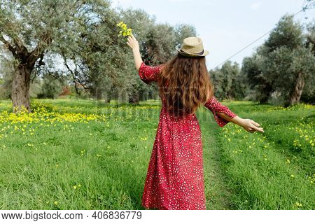 Young Woman In Red Dress And Hat, Enjoying Summer And Nature In Yellow Flower Field At Sunset, Harmo