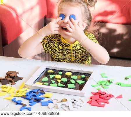 Little Girl Plays With Geometric Mosaic Details And Has Fun And Dabbles. Game For Creativity.  Leisu