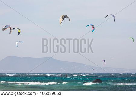 Fuerteventura, Spain - May 10, 2013. Kite Surfers, Kite Surfing Off The Coast At Corralejo, Fuerteve