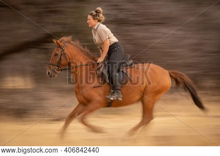Slow Pan Of Blonde Riding Past Woods