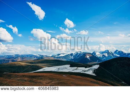 Sunshine In Highland Valley Near Beautiful Glacier On Hill Side. Sunny View To Snowy Rocks And Giant