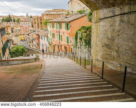 Perugia, Picturesque View Of The Medieval Aqueduct, Pedestrian Street Surrounded By Colorful Houses,