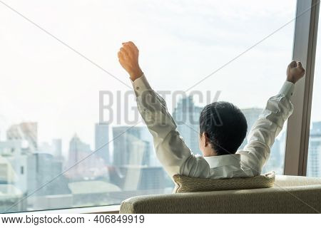 Business Achievement Concept With Happy Businessman Relaxing In Office Or Hotel Room, Resting And Ra