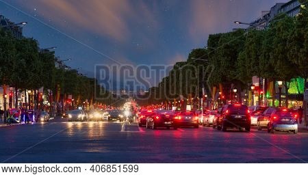Paris, France - May 29, 2015: Traffic At Champs Elysees At Evening With Starry Sky