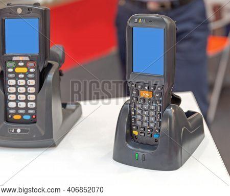 Handheld Computer Barcode Scanner Device At Charging Station Dock