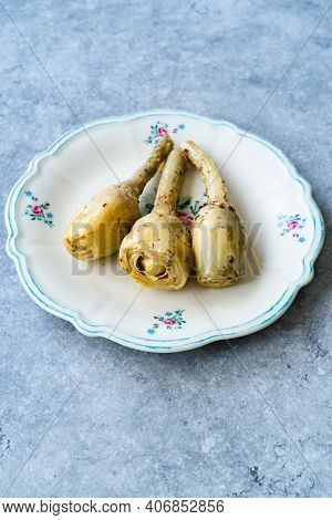 Marinated Spicy Artichoke Hearts In Olive Oil Served With Root.