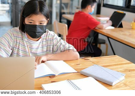 Boy Girl Student Wearing Face Mask Studying Learning Lesson Online. Remote Meeting Distance Educatio