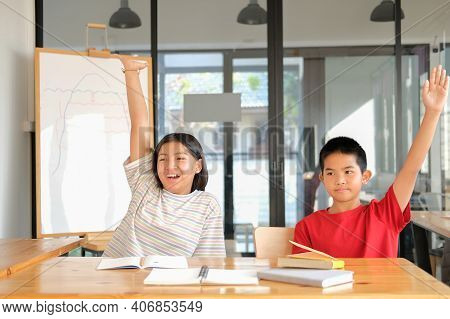 Girl Boy Student Studying Raising Hand In Classroom. Learning Education At School