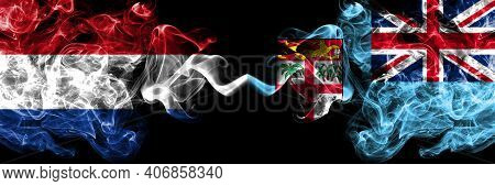 Netherlands Vs Fiji, Fijian Smoky Mystic Flags Placed Side By Side. Thick Colored Silky Abstract Smo