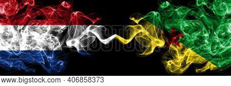 Netherlands Vs France, French Guiana Smoky Mystic Flags Placed Side By Side. Thick Colored Silky Abs