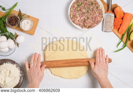 The Process Of Cooking Uzbek Manti At Home, The Ingredients Are Meat, Vegetables, Dough. Woman's Han