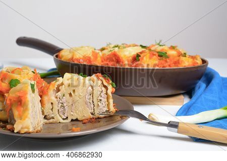 Uzbek Manti At Home In A Frying Pan With Stewed Vegetables, Ingredients-meat, Vegetables, Dough. Top