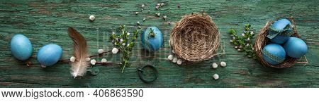 Pastel Blue Colored Easter Eggs On Green Shabby Wood. Country Style Easter Decoration With Flowers A