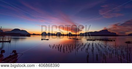 Beautiful Sunset Or Sunrise With Dramatic Colorful Sky Clouds Over Calm Sea And Reflection In Water