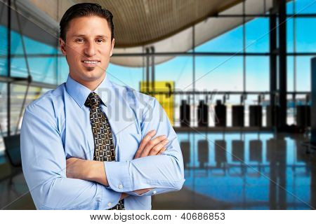 Young successful businessman at airport