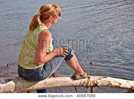 Middle Aged Woman Relaxing At Lake