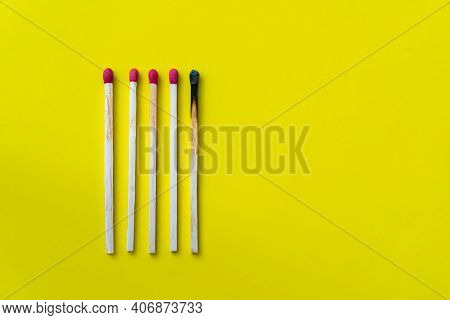 Success, Defeat, Achievement. The Concept Of Happiness. Matches On A Yellow Background. Burnt Dark M