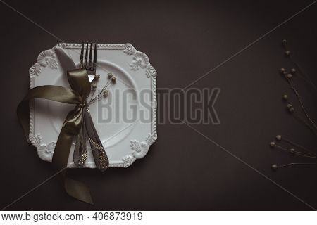 Romantic Tabble Setting With Ribbon, Plates, Cutlery On Black Background. Empty Plate. Mockup Design