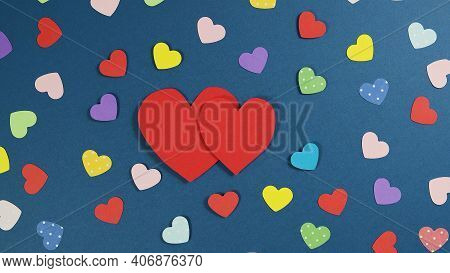 Holiday Abstract Valentine Background With Multicolored Paper Hearts. Cutted Paper Heart On Blue Bac