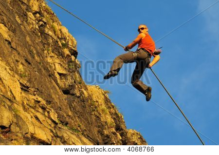 Rock Climber Repelling Of A Cliff