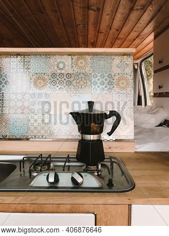 Open Kitchen In A Camping Van - Cooking Coffee In The Open Air - Vanlife