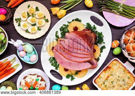 Traditional Easter Ham Dinner. Above View Table Scene On A Dark Wood Background. Ham, Scalloped Pota
