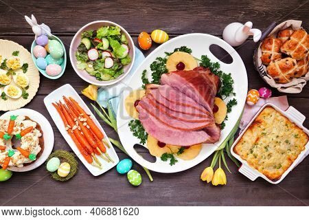 Traditional Easter Ham Dinner. Top Down View Table Scene On A Dark Wood Background. Ham, Scalloped P