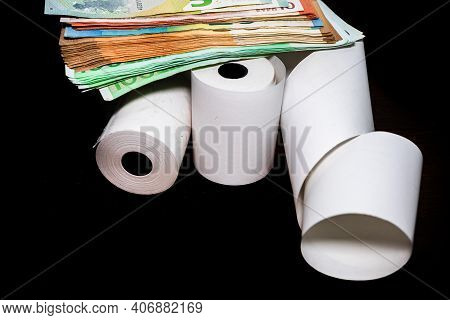 Roll Of Cash Register Tape And Money Isolated On Table. Planning Savings, Spending Money Or Business