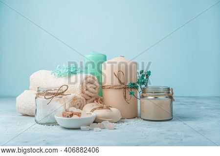Spa Set With Candles On A Light Blue Background. Side View With Copy Space.