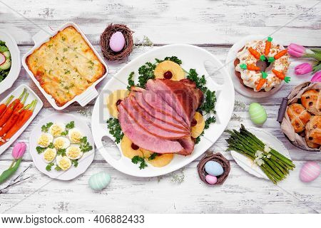 Classic Easter Ham Dinner. Top Down View Table Scene On A White Wood Background. Ham, Scalloped Pota