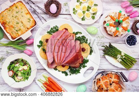 Traditional Easter Ham Dinner. Top View Table Scene On A White Wood Background. Ham, Scalloped Potat