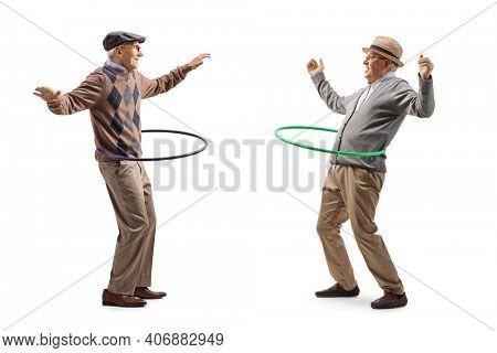 Happy elderly men spinning hula hoops isolated on white background