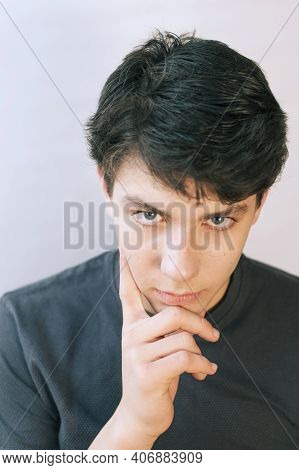 A Teenager With A Sad Face And A Serious Look. He Has A Beautiful Face And Dark Hair. He's Sad Becau
