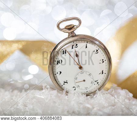 New Years Eve Countdown. Almost Midnight On An Old Pocket Watch, Bokeh Background.